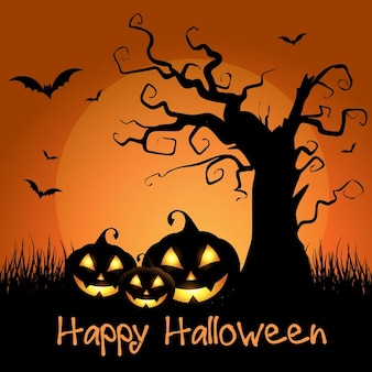 Spooky halloween background with tree and pumpkins