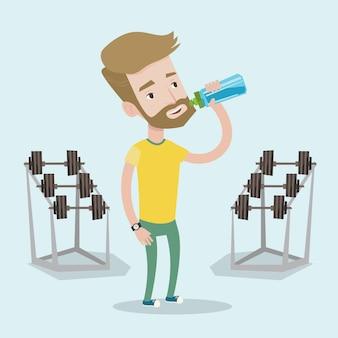 Sportive man drinking water  .