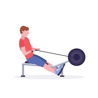 Sports man doing exercises on rowing machine guy working out in gym on training apparatus crossfit healthy lifestyle concept  white background