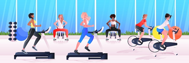 Sports women group doing physical exercises mix race girls training in gym aerobic workout healthy lifestyle concept