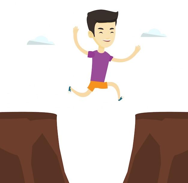 崖の図を飛び越えてスポーツマン。