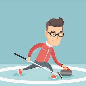 Спортсмен играет в керлинг на катке.