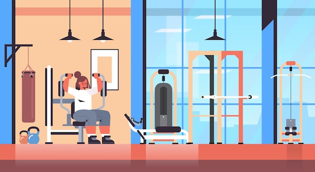 건강한 라이프 스타일 개념 현대 체육관 인테리어를 밖으로 작동하는 물리적 운동을 하 고 훈련 장치 소녀에 운동 sportswoman
