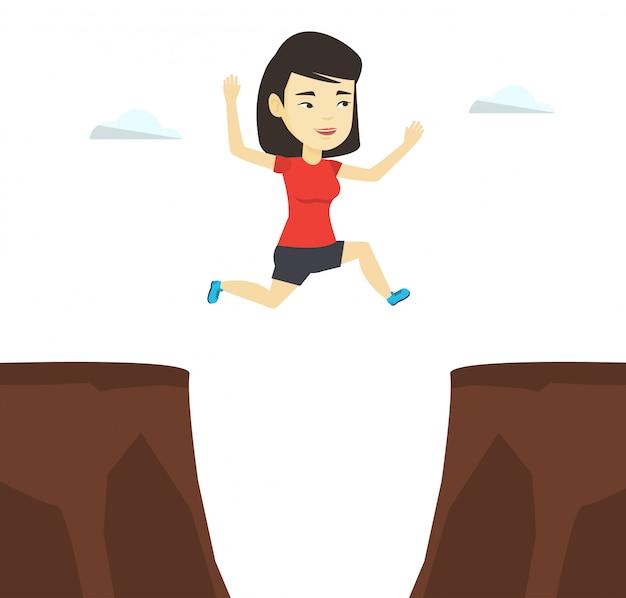 崖の図を飛び越えてスポーツウーマン