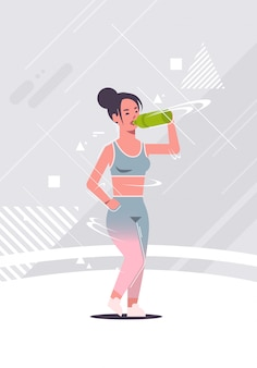 Sporty girl bodybuilder drinking fresh water or protein shake sportswoman