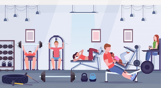 Sporty people doing exercises men women working out together on training apparatus in gym workout healthy lifestyle concept modern health club studio interior horizontal