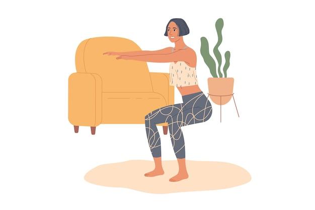 집에서 쪼그리고 운동을 연습하는 스포티 한 여자.