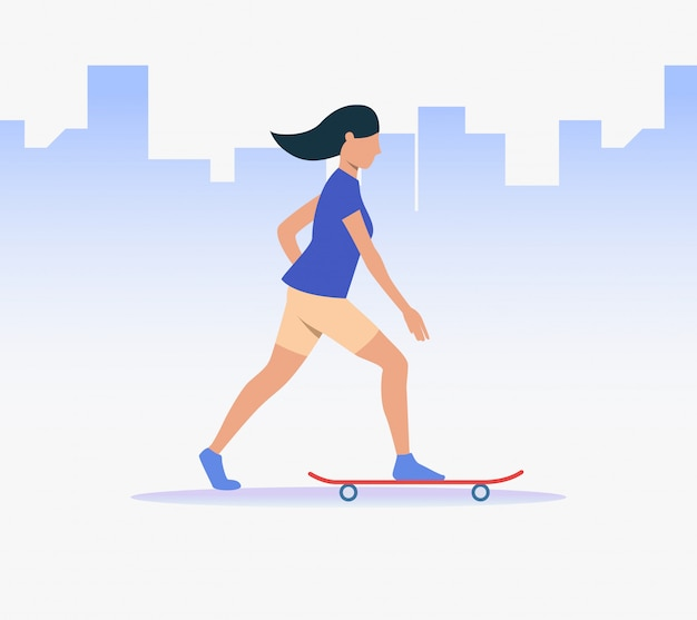 Sporty woman riding skateboard
