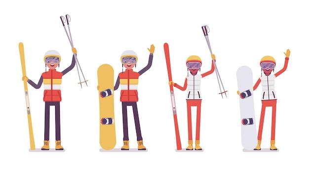 スポーティな若い男性、女性はリゾートで冬の野外活動を楽しむ