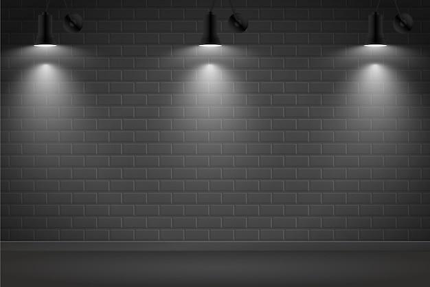 Точечные светильники на темном фоне кирпичной стены
