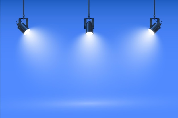Spot lights on studio blue wall background