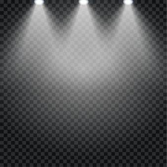 劇場コンサートステージのスポットライト効果。透明な背景にスポットライトで照らされた背景の抽象的な光る光。