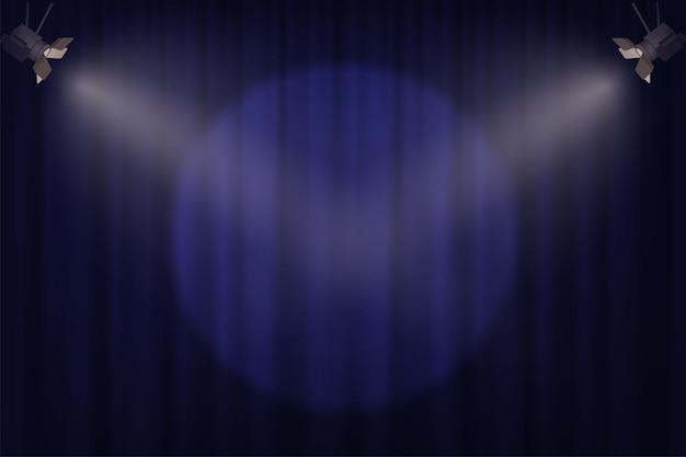 青いカーテンの背景にスポットライト