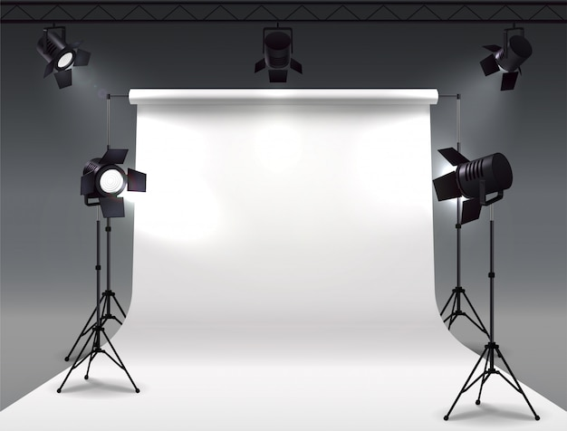 Spotlights realistic composition with cyclorama and studio spot lights hanging on reel and mounted on stands