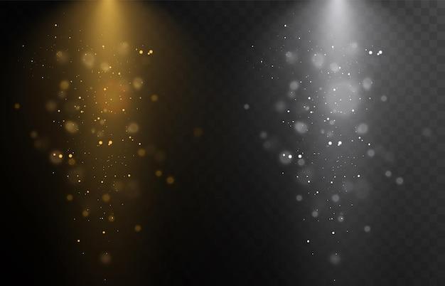 透明な背景に分離されたスポットライトセット金色の光線でベクトル光る光の効果