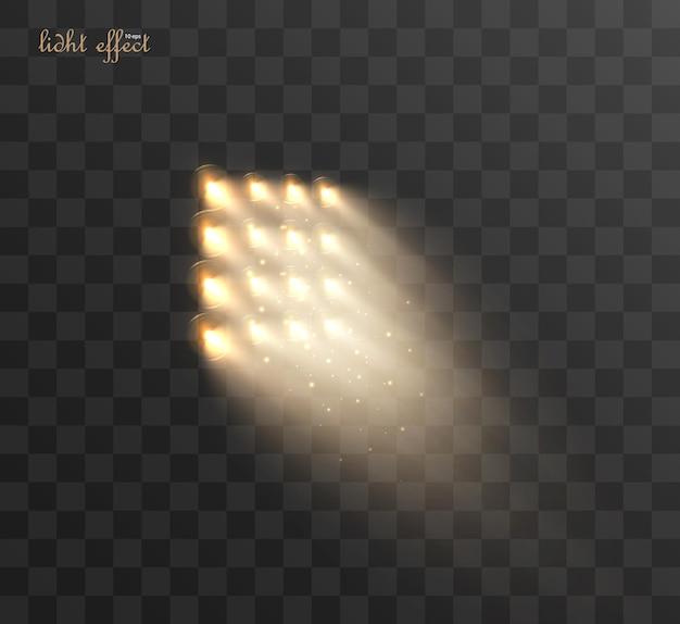 スポットライトは透明に分離されています。金色の光線で輝く光の効果。