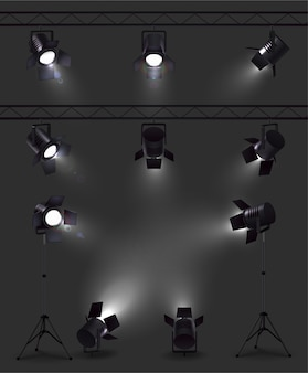 Spotlights set of realistic images with glowing spot lights from different angles with stands and reels