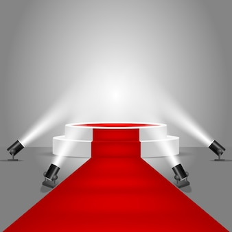 Spotlights and stage podium with red carpet
