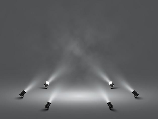 밝은 흰색 조명이 빛나는 무대 스포트라이트. 조명 효과 프로젝터. 스튜디오 프로젝터의 그림입니다.