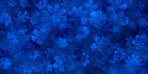 青い色の様々な花の春の背景