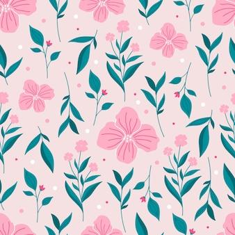 ピンクの花と春の植物のシームレスなパターン