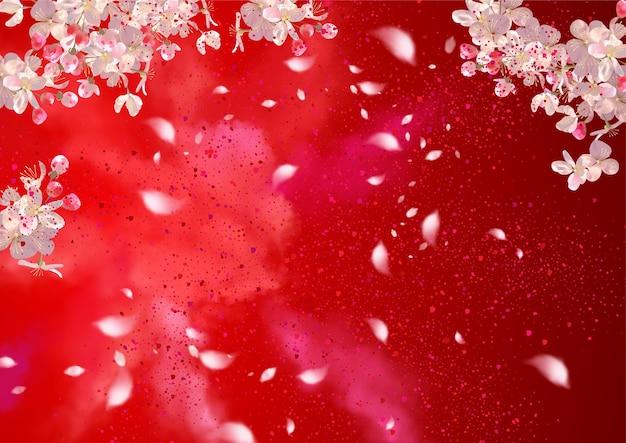 Весенние ветви сакуры на красном фоне