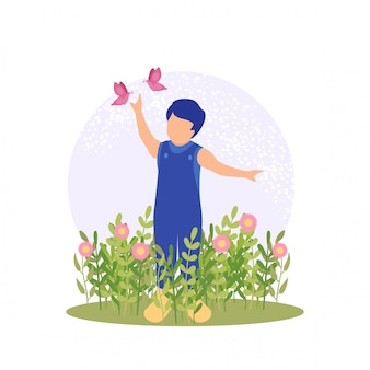 Spring cute boy playing flower and butterfly at garden