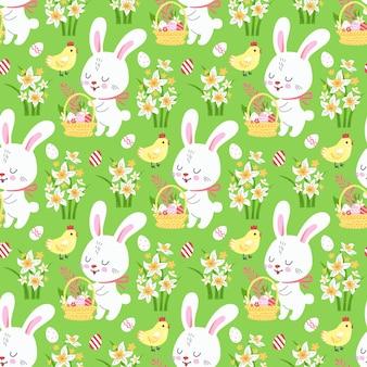 壁紙とファブリックのデザインのためのかわいいウサギと春のイースターの背景。ベクター