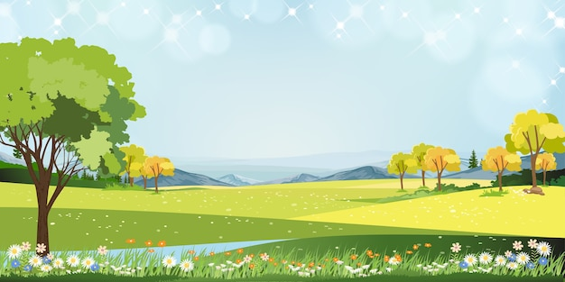青い空と丘の上の牧草地、緑の野原のパノラマの田園地帯、山と草の花と晴れた日の村の春の風景