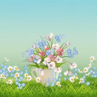 잔디와 컵에 아름다운 꽃다발 봄 풍경