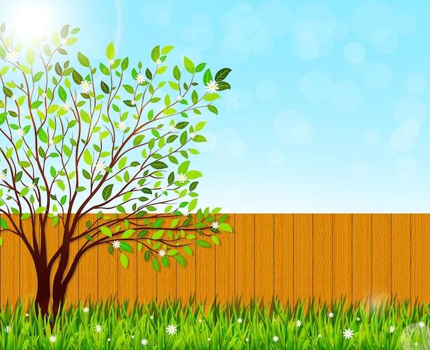 Предпосылка природы весны с зеленой травой и цветущим деревом. дизайн иллюстрации