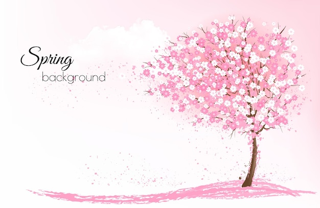 Spring nature background with a pink blooming sakura tree.
