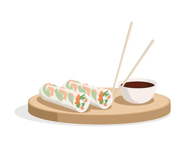 Спринг-роллы и соевый соус с палочками на тарелке