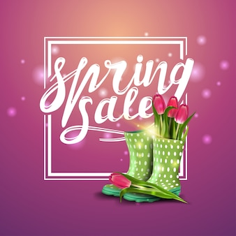 Spring sale, pink banner with tulips in women's rubber boots