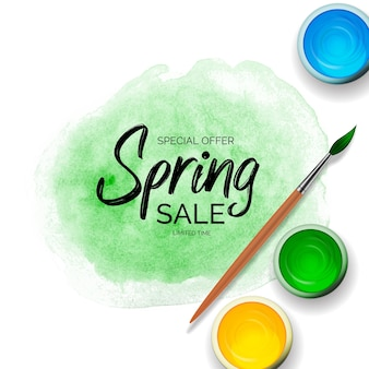 Spring sale with green paint strokes, tins with gouache, acrylic and realistic 3d wooden brush.