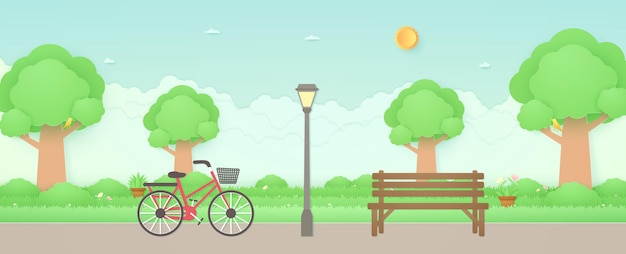 Spring time bicycle in the garden with wooden bench and street light bird on treesflower on grass