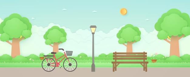 Весенний велосипед в саду с деревянной скамейкой и уличным фонарем птица на деревьях, цветок на траве