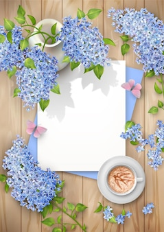 Spring top view composition with blank sheets of paper, lilac in a ceramic vase and a cup of coffee