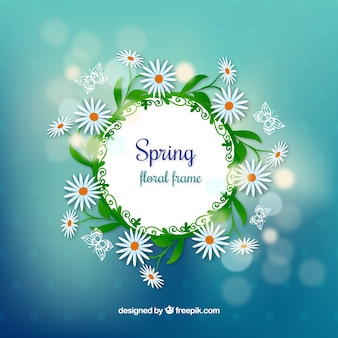 Spring wreath with daisies on bokeh background