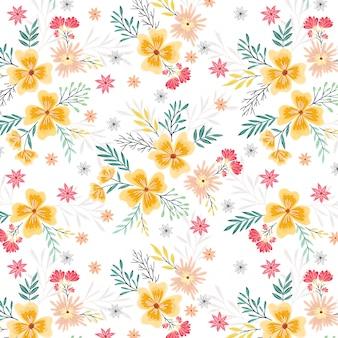 春の黄色とピンクの花のシームレスパターン