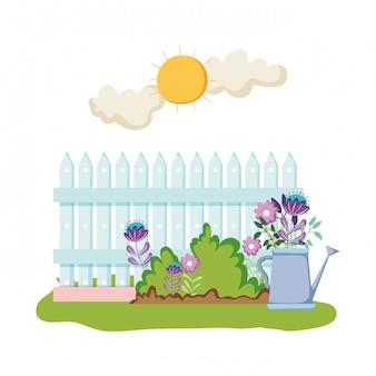 Sprinkler of garden with fence in the field scene