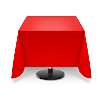 Square table with red tablecloth.