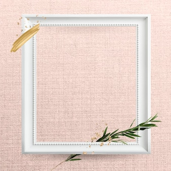 Square white wooden frame with eucalyptus branch