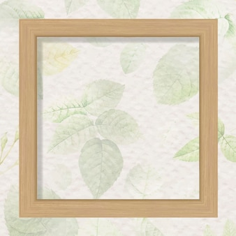 Square wooden frame on foliage pattern background