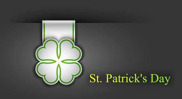 Плакат ко дню святого патрика. клеверный лист и приветственная надпись зелеными цветами.
