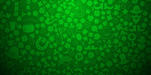 St. patrick's day background made of clover leaves and other symbols in green colors