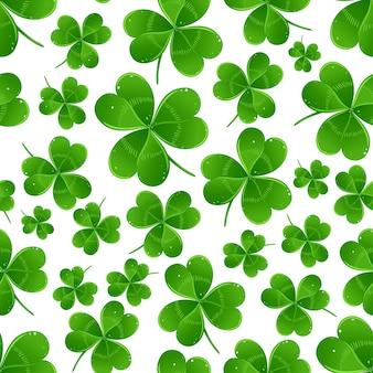 緑のクローバーの葉を持つ聖パトリックの日の背景。シームレスパターン。