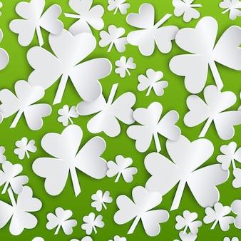 聖パトリックの日の緑の白いシャムロックの葉とのシームレスなパターン背景
