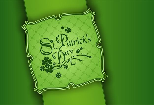 День святого патрика, плакат ко дню святого патрика. клеверный лист и приветственная надпись зелеными цветами.
