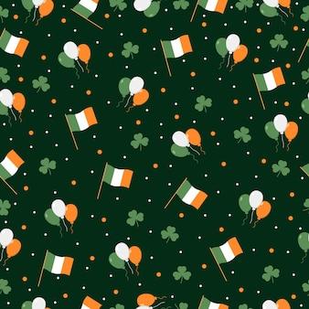 緑の背景にアイルランドの旗、クローバー、アイルランドの旗の風船と聖パトリックの日のシームレスなパターン。挨拶、包装紙、壁紙。
